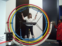 A girl is strapped into the gyroscope at the Carnegie Science Center in Pittsburgh, PA