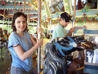 A girl and a boy ride the carousel at Kennywood Park, near Pittsburgh